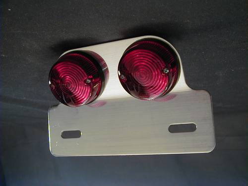 TAILLIGHT PAIR WITH PLATE WITH E-MARK<br/>DUAL LAMP, 12 VOLT 23/8 WATT&nbsp;&nbsp;